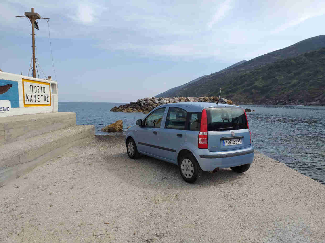 karavostamo port showing a car of ikarian rental